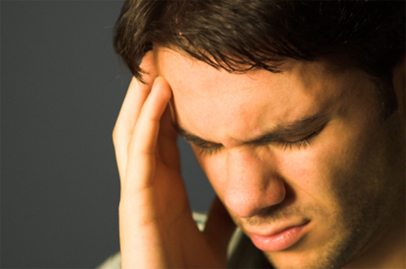 Man touching his head sure to stress