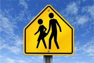Yellow sign with two stick figures depicting sexual harassment
