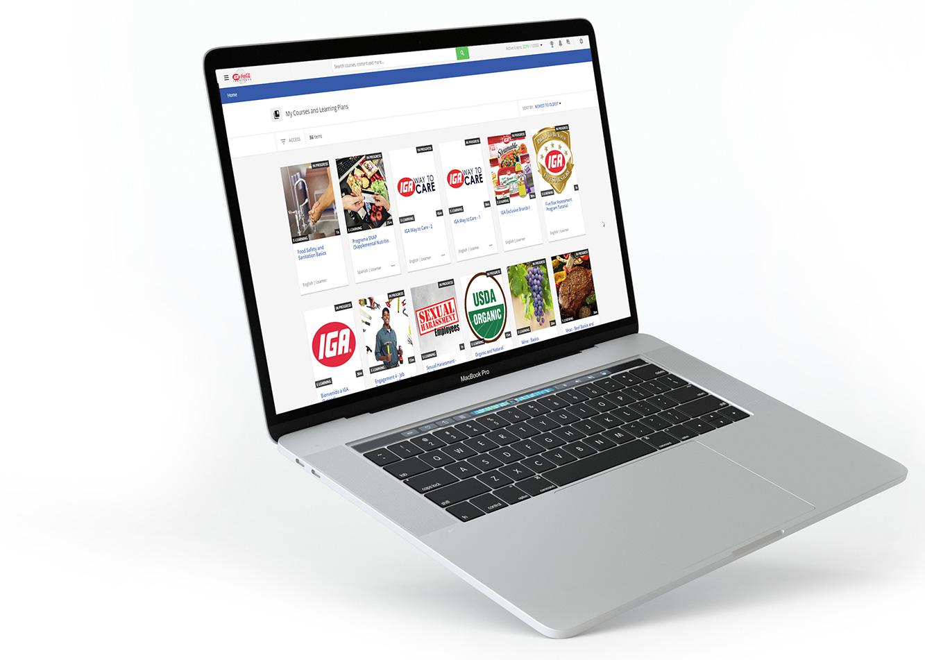 Computadora portátil flotando que muestra el Dashboard del LMS con cursos