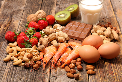Table with strawberries, nuts, shrimp, eggs, chocolate, milk and kiwi