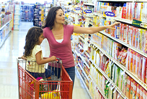 Mom and daughter doing groceries in an aisle